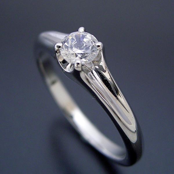 画像1: 隠れた4本爪デザインの婚約指輪 (1)